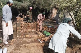 5-A-WASH-Officer-supervises-construction