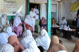 Head-of-Afghan-Delegation-talking-to-members-of-a-Village-Organisation---Binkot-Swat